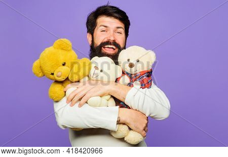 Smiling Bearded Man Hugs Teddy Bears. Happy Bearded Man With Plush Toys. Gift And Present.