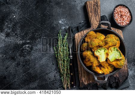 Roasted Crumbed Broccoli In A Pan. Black Background. Top View. Copy Space