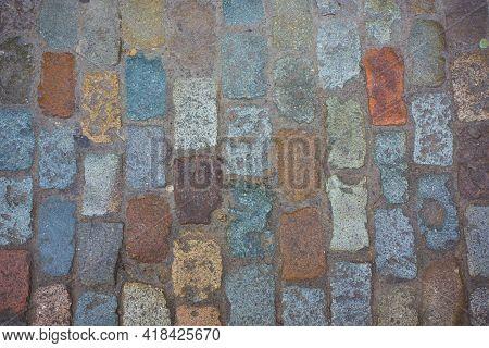 Beautiful Sidewalk Of Multicolored Stone, Medieval Cobblestone Road. Abstract Texture Or Background.