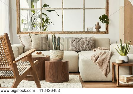 Interior Design Of Living Room With Stylish Modular Beige Sofa, Wooden Coffee Tables, Plants, Pillow