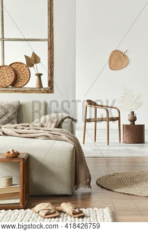 Stylish Composition Of Living Room With Design Beige Sofa, Wooden Stool, Book, Carpet, Chair,  Decor
