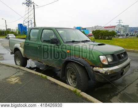 St. Petersburg, Russia - June 2020: Old Dirty Rusty Pickup Nissan. Popular Car Manufacturer For The