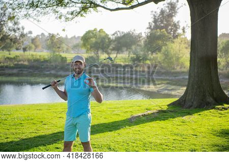 Golfer Man Playing Golf On Beautiful Sunny Green Golf Course.