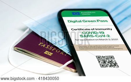 The Digital Green Pass Of The European Union With The Qr Code On The Screen Of A Mobile Phone Over A
