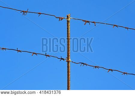 Vintage Metal Grid With Barbed Wire On Blue Sky In Sunny Day, Restricted Area Diversity