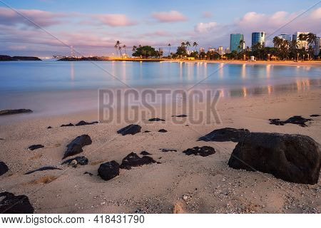 sunset over Honolulu skylineand Magic Island Lagoon, Oahu, Hawaii