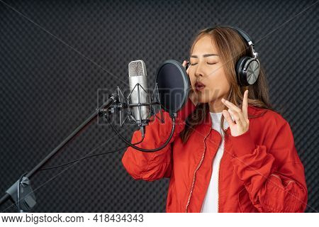Asian Singer Woman In A Recording Studio Using A Studio Microphone With Passion In Music Recording S