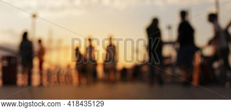 Blur Abstract tropical seafront light blur blinking horizontal long background with people. Soft focus.