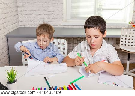 Preschooler Little Boy Drawing In Nursery Room. Happy Family Drawing Pictures. Cute Boys Studying Dr