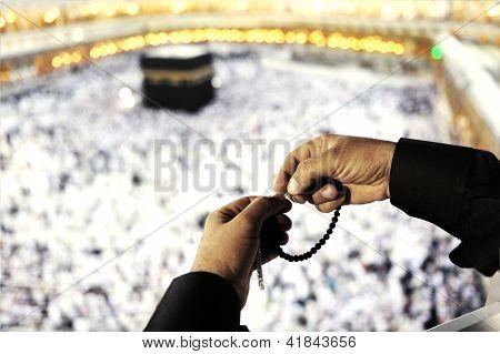 Muslim Arabic man praying at Kaaba in Mecca