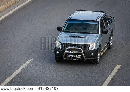 Alanya, Turkey  - April 14  2021:  Silver  Pickup Isuzu D-max  Is Driving Fast On The Street On A Wa