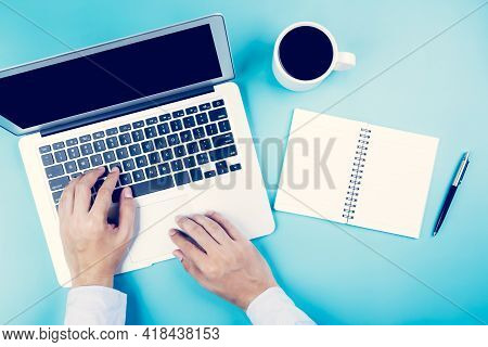 Hand Of Businessman Working On Laptop Computer With Notebook And Cup Of Coffee On Desk In Office, Ha