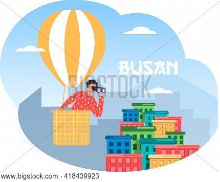 Man In Hot Air Balloon Looks Through Binoculars At Big City Bysan. Guy On Air Excursion In South Kor