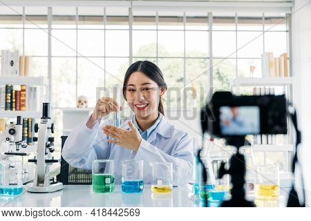 Portrait Of Young Female Doctor Wearing Lab Coat Recording Online Video Class And Vlog On Medical Re