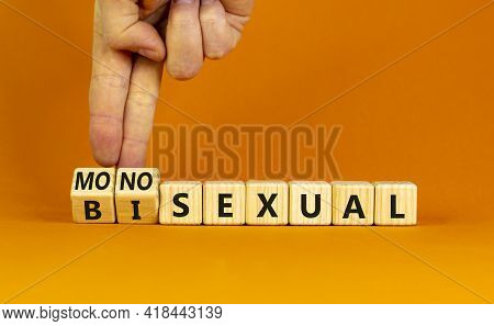 Monosexual Or Bisexual Symbol. Doctor Turns Wooden Cubes And Changes The Word 'monosexual' To 'bisex