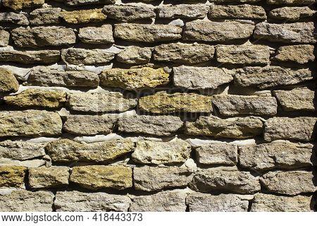 Rough Stone Masonry Texture. Stone Wall. Horizontal Image.
