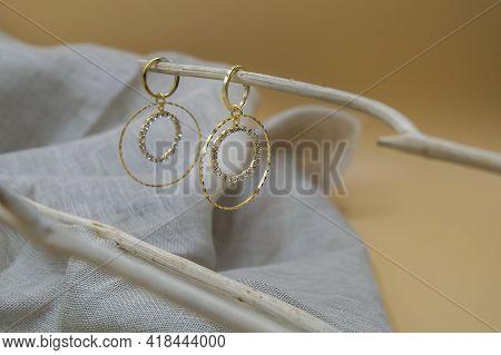 Golden Jewellery Setup. Golden Jewelry Fashion Photography. Golden Earrings Fashion Photography. Ear