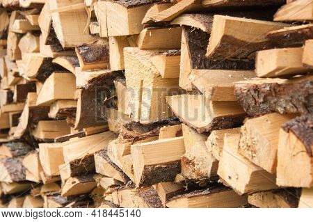 Wood For The Village Stove Or Fireplace Stacked In A Stack. Dry Wood Texture. Ecologically Clean Fue