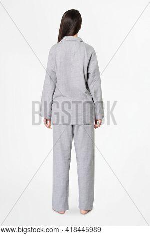 Woman in gray pajamas comfy sleepwear apparel rear view