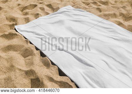 White beach towel on the sand