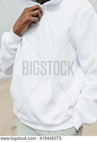 African American man in hoodie posing outdoor photoshoot