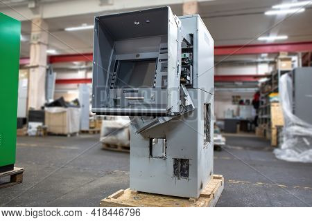 Hacked Atm Machine With Cut Holes In The Safe. An Empty Atm From Which Money Was Stolen.