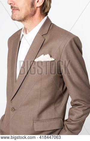 Bussinessman in brown suit studio portrait