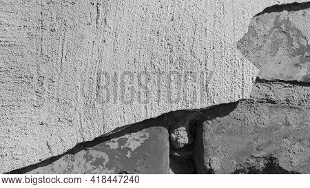 Brick Wall And Gray Plaster. Background Texture Of An Old Brick Wall Of A House With Gray Cement. Wa