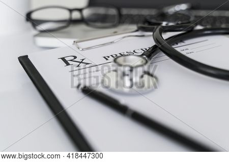 Medical Concept With Stethoscope On Rx Prescription.