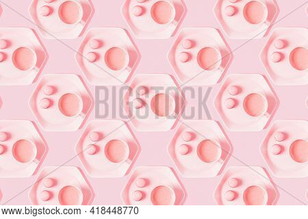 Pattern Of Coffee With Macarons On Pastel Pink Background.