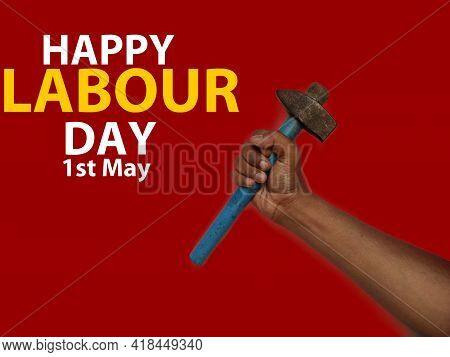 Happy World Labour Day In 1st May Background. Labour Day Simbolism Concept Hand With Hammer. Interna