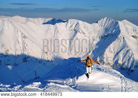 Young woman climbing in the Transylvanian Alps, Carpathians, Romania, Europe