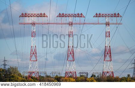 High Voltage Post. Tree High Voltage Towers. Group Of Transmission Towers Or Power Tower, Electricit