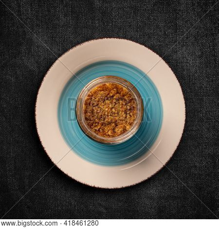 Flat Lay Of Mousse With Crumbs Topping Served In Glass