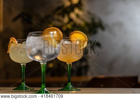 Three Glass Of Gin And Tonic Cocktail On Bar Counter