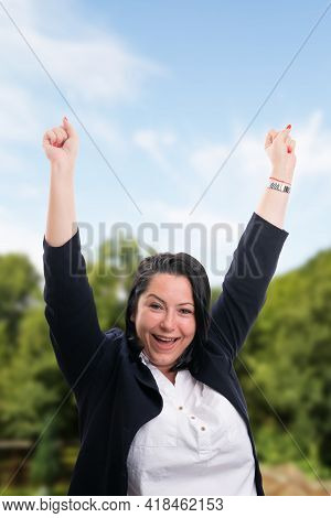 Cheerful Businesswoman Wearing Smart Casual Suit Making Celebrating Gesture With Fists And Happy Exp