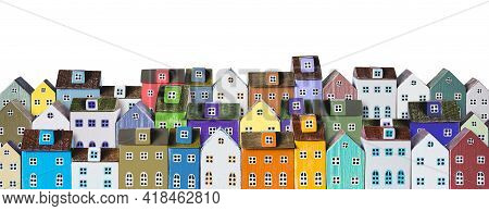 Colorful Miniature Houses Arranged In A Rows Isolated On A White Background. Urban City Background B