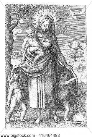 The personification of the virtue of Love carries a child on her arm and two children hide under her cloak. She has a halo around her head. In the background a landscape.
