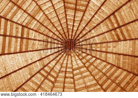 Wooden Roof From Bottom In Orange Tone. Abstract Pattern And Background.