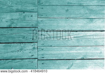 Wall Made Of Uncutted Weathered Wood Boards In Cyan Tone. Abstract Architectural Background And Text