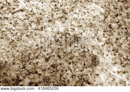 Granite Surface As Background With Blur Effect In Brown Tone. Abstract Background And Texture For De
