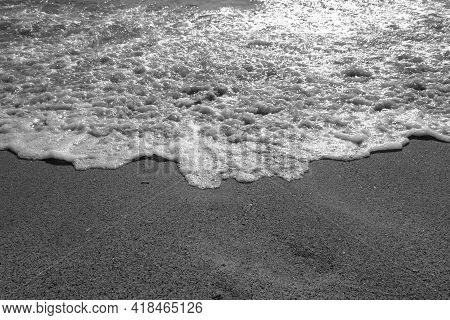 Coming Wave And Beach In Black And White. Seasonal Natural Background.