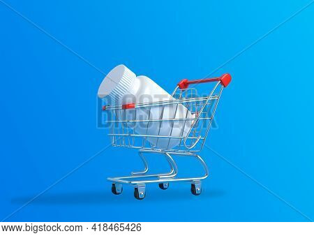 Pill Bottle In A Metal Shopping Cart On Blue Background With Copy Space. Medicine Concepts. Minimali