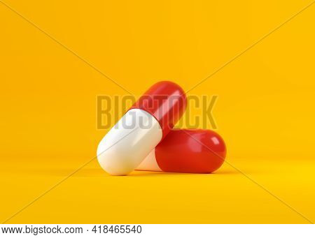 Pair Of Red-white Pharmaceutical Medicine Pills On Yellow Background. Medicine Concepts. Minimalisti