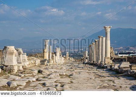 Empty Colonnaded Street In Antique City Laodicea, Near Denizli, Turkey. All Columns Made In Corinthi