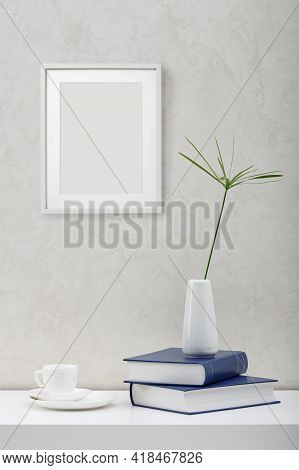 Blank Picture Frame Mockup On White Wall. White Living Room Design. View Of Modern Scandinavian Styl