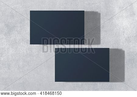 Blank dark blue business card in front and rear view