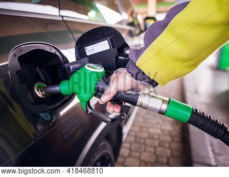 Man Hand Refilling Gas On Gas Station. Man Refill And Filling Oil Gas Fuel At Station.gas Station -