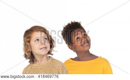 Pensive children looking up isolated on a white background