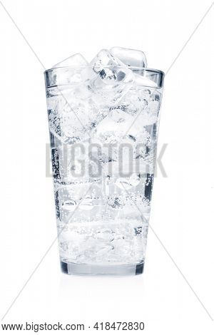 Glass of water with ice cubes. Tonic water drink. Isolated on white background